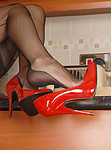High.Heels Pics: We catch Saffy in the kitchen, but not working for long! Play is much more fun, and our Essex girl in red stiletto's knows how to play! Soon showing all this trim curvy babe is a delight in bullet bra, vintage powernet girdle and black Eleganti ff's.
