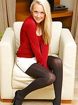 Pantyhose Pics: Sexy blonde Lucy looks adorable as she removes her tight red top and white mini skirt to reveal her black pantyhose