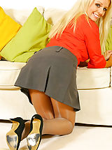 Pantyhose Pics: Busty blonde Elena in a smart secretary outfit with thong and pantyhose.
