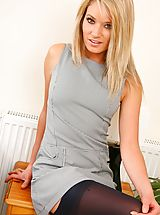 The gorgeous Emma C stripping from her grey Secretary Outfit and black stockings and suspenders
