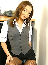 Carla in a naughty secretary outfit with lingerie and pantyhose.
