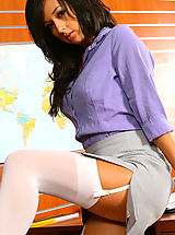 Only Tease Pics: Beautiful brunette secretary Laura A strips from her cute grey suit and purple shirt to give us a glimpse of her sexy white lingerie