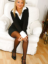 Secretary Pics: Blonde beauty Liana Lace relaxes on her sofa in nothing but holdup stockings.
