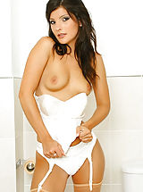 silk stockings, Sexy brunette Lou L wearing a nurse's uniform with tan stockings