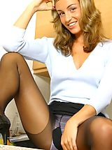 Pantyhose Pics: Melanie looking delightful in a sexy secretary outfit.