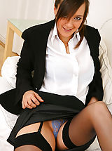 Sexy Secretary, Stunning executive secretary Nadia E finishes off her work and then undresses from her sexy skirt suit