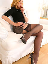 Only Tease Pics: Stunning beauty secretary slips out of her outfit with gorgeous lingerie.