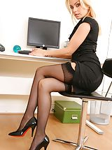 Natasha appears to be the perfect secretary in her black minidress and stockings. Non Nude