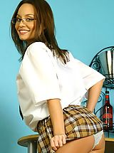 Secretaries, Carla in sexy college uniform with tartan skirt.
