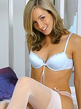 Grogeous Mel in sexy blue lingerie and stockings