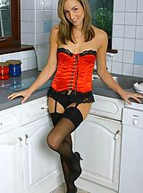short skirts, Melanie in red satin basque with black stockings