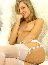 Lingerie Pics: Melanie looking stunning in sexy white lingerie and stockings.