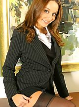 Secretary Pics: Carla in a smart suit with sexy lingerie.