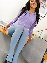 Only Tease Pics: Beautiful brunette Bethany in a smart office outfit with blue pantyhose.