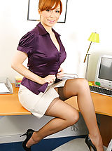 Secretary Pics: Saucy secretary in smart office outfit with light lingerie and stockings.