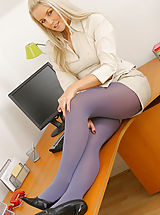 Sexy blonde secretary Donna T slowly strips in her office to reveal her gorgeous purple pantyhose