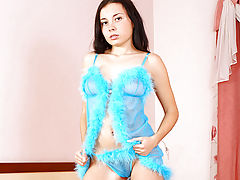 Lovely Nubile Cheryl pleasures her pussy on a bed of soft pink