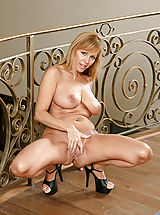 Heel Crush, Seductive mature babe spreads her legs and flaunts her tantalizing pink pussy