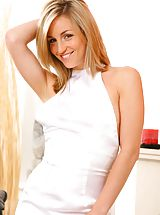 Melanie looking gorgeous as she strips from her sexy white dress revealing her gorgeous white stockings and suspenders