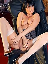 Spike Heels, Gorgeous brunette removes her satin camisole and poses nude in only her white stockings.