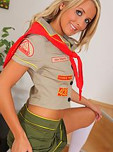 Teen Dreams Pics: Cheeky blonde cookie girl looks amazing as she strips out of her uniform and flaunts her hot body in just knee high socks.