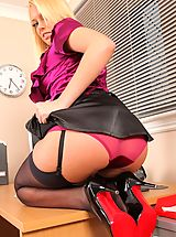 Upskirt Pics: Saucy secretary gives a sexy striptease and reveals her red lingerie.
