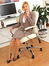 Long Legs, Mature Ginger Lynn tames her horny pussy with her vibrating wand toy while she is alone in the office