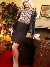 Naughty Secretary, Blonde slips out of her tight black knee-length skirt suit and reveals her sexy lingerie.