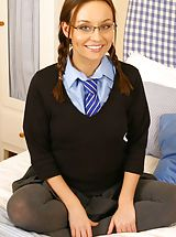 Carla on the bed in cute college uniform.