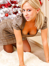 Your Gorgeous blonde secretary wishes you a happy xmas as she slips out of her tight outfit. Non Nude