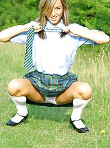 minirock, Melanie takes a wander in the park wearing a college uniform consisting of tartan skirt