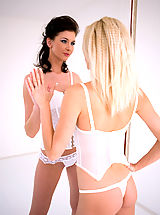 Two nasty lesbian beauties in white lingerie