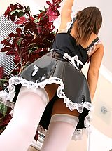 Jade teases her way out of her french maids outfit while cleaning the office.