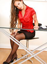 Secretary Pics: Michaela looks delightful as she slowly removes her sexy skirt suit to reveal her gorgeous black stockings and suspenders