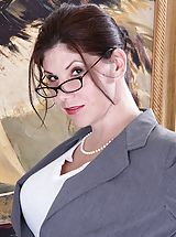 Sexy Legs, Arden Delaney peels off her business suit after work.