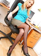 Naughty blonde secretary Hayley-Marie does a sexy strip. Non Nude