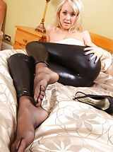 Lucy Anne in a strapless pink top, skin tight black leggings and matching high heels.