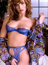 All-natural, auburn haired beauty Brittany Shaw looks lovely in blue matching lingerie!