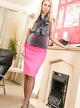 Sexy Secretaries, Gorgeous blonde wearing a grey opaque blouse with a long pink skirt. Non Nude