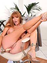 Darla Crane, Brunette Anilos Darla Crane stretches her mature pussy with a glass toy in the office