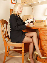 Secretary Pics: Not your usual business brain, however Clair Lou has some high interest property on her legs...some very special bow heel Harmony Point fully fashioned nylons. So when she's down to bare basics (nylons, girdle and heels!) you can be sure to shed some of y