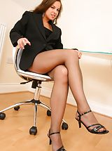 Michaela looks amazing as she seductively teases her way out of her gorgeous pinstripe jacket and mini dress to reveal her sexy brown pantyhose Non Nude