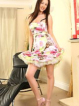 Brunette Carole wearing a beautiful and colourful summer dress.