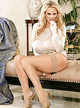 corsets stockings, Kelly wears a see thru top and rubs on her clit on a chaise lounge.
