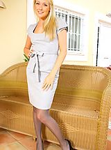 Lucy Anne looks amazing as she teases her way out of her sexy secretary outfit