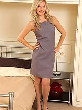 Secretaries, Elle is wearing a shift dress with tan stockings