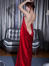 Seductive tramp teases with a swath of silky red cloth