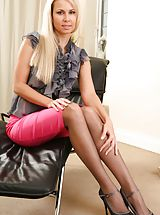 Only Tease Pics: Gorgeous blonde wearing a grey opaque blouse with a long pink skirt.
