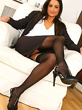 Sexy Secretaries, Gorgeous brunette Isla looks stunning in her sexy brown secretary outfit