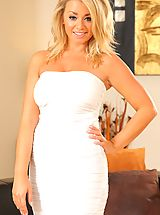 Busty blondge Melissa D in white minidress and suspenders
